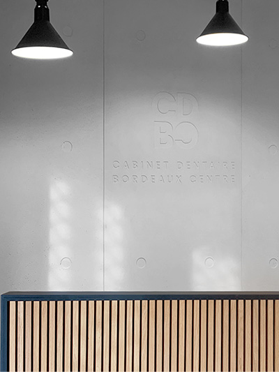 Logo for CDBC in concrete wall - front